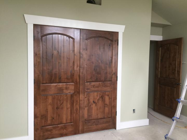 upstairs guest bedroom double closet doors stained, poly