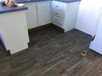 Kitchen remodel cabinets repainted vinyl floor laminate countertop